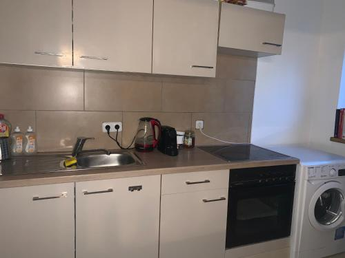Küche/Küchenzeile in der Unterkunft Gemütliche Wohnung