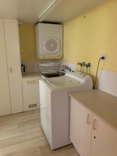 A kitchen or kitchenette at Dulkara Holiday Units