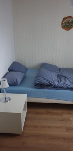 A bed or beds in a room at Eidsvoll room