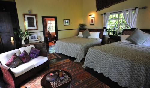A bed or beds in a room at Residence on the Rocks