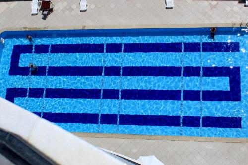 The swimming pool at or close to FLAT A BEIRA Mar BAHIA SUITES