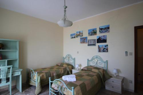 A bed or beds in a room at Difrontealmare Apartments