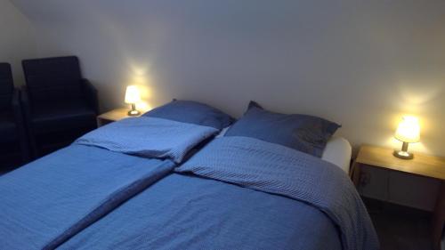 Un ou plusieurs lits dans un hébergement de l'établissement De Blauwvoet Studio