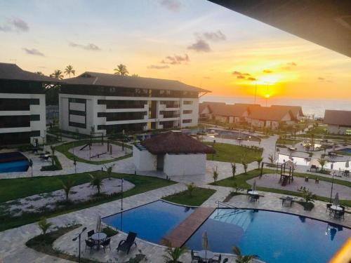 Uma vista da piscina em Cupe Beach Living Beira Mar ou nos arredores