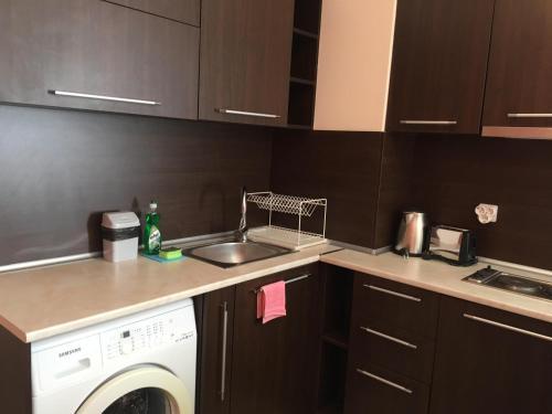 A kitchen or kitchenette at Bay Apartments Sozopol