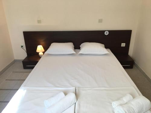 A bed or beds in a room at Bay Apartments Sozopol