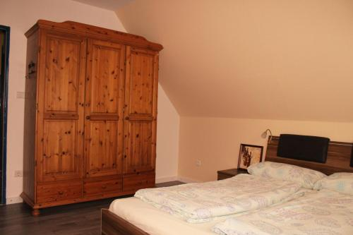 Ein Bett oder Betten in einem Zimmer der Unterkunft Ferienwohnung zur Ostsee