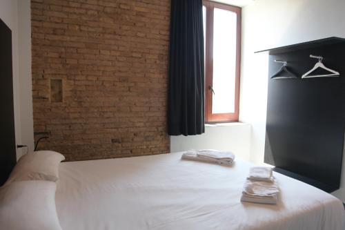 Cama o camas de una habitación en Soho Valencia