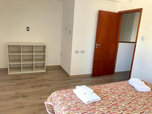 Una cama o camas en una habitación de Alquiler Temporario Firmat - Libertad
