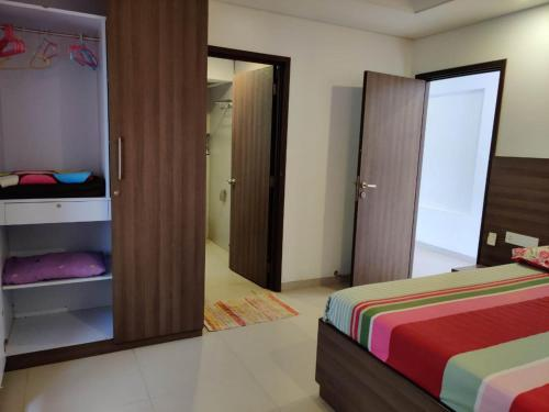 A bed or beds in a room at Leisurebay Goa