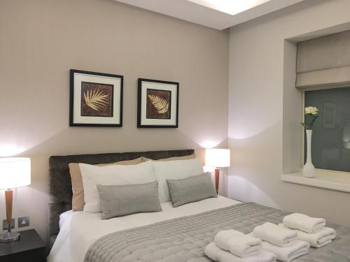 A bed or beds in a room at Trafalgar Luxury Suites