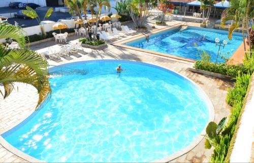 Вид на бассейн в Apart Acquaville Caldas Novas или окрестностях