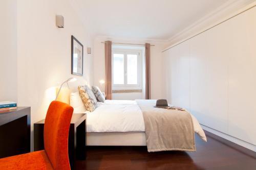 Un ou plusieurs lits dans un hébergement de l'établissement Baixa Deluxe Apartments by Altido