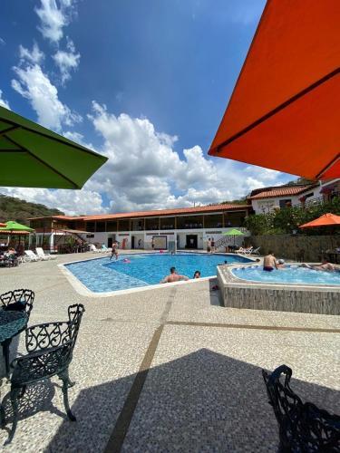 The swimming pool at or near Hotel La Montaña San Gil