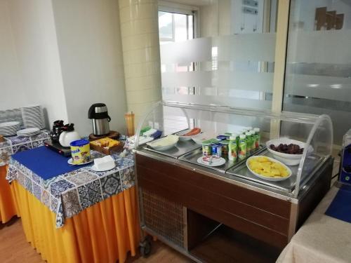 Cuisine ou kitchenette dans l'établissement Jardins da Ria