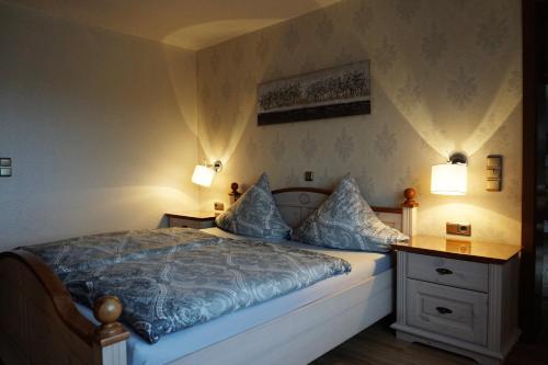 Ein Bett oder Betten in einem Zimmer der Unterkunft Ferienwohnung Grimmelmann