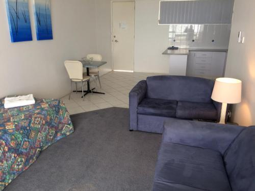 A seating area at The Sands Holiday Apartments