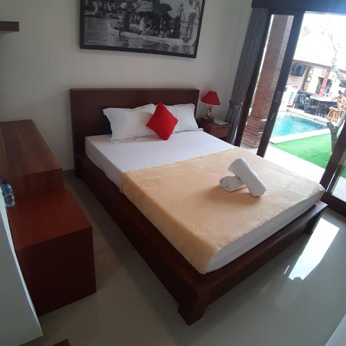 A bed or beds in a room at D&D homestay