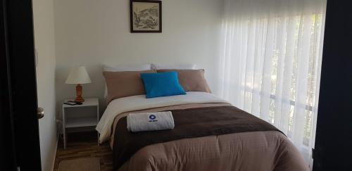 A bed or beds in a room at Kalos Meraki ApartaSuites
