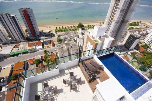 A view of the pool at Apartamento mobiliado e confortável em candeias or nearby