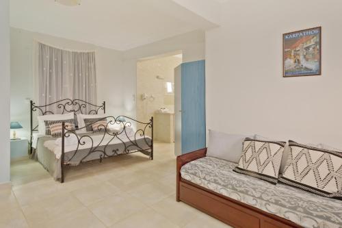 A bed or beds in a room at Kalimera Karpathos