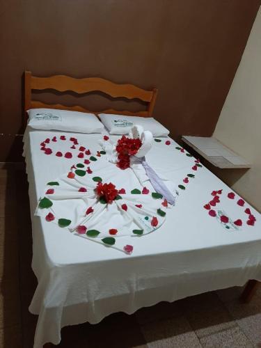 A bed or beds in a room at Gruta Hotel De Serra
