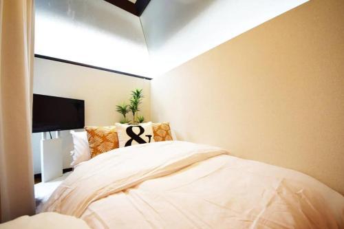 เตียงในห้องที่ A2:210 都市の中でものんびり!最強エリア新宿!