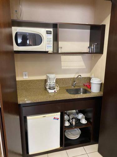 A cozinha ou cozinha compacta de CHARMOSO FLAT NA ALAMEDA SANTOS
