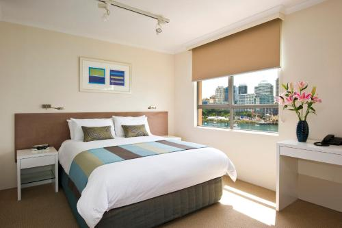 מיטה או מיטות בחדר ב-Harbourside Apartments