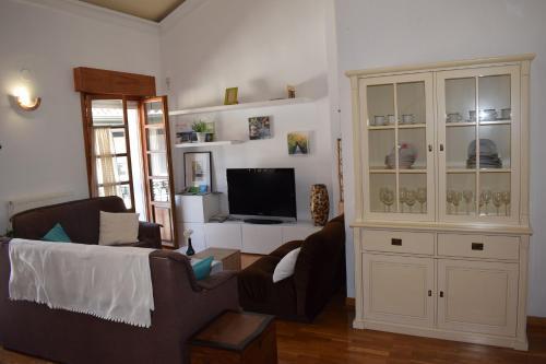 Télévision ou salle de divertissement dans l'établissement Apartamento Belmecher