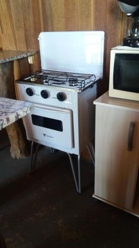 A kitchen or kitchenette at Fazendinha Pompéia