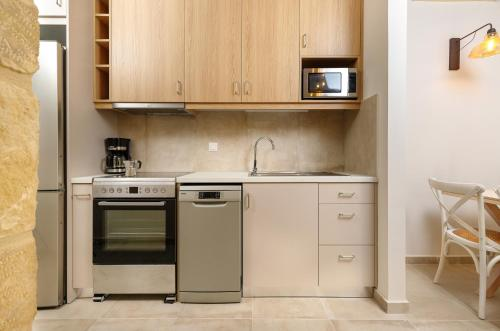 A kitchen or kitchenette at Zefyros Apartments and House