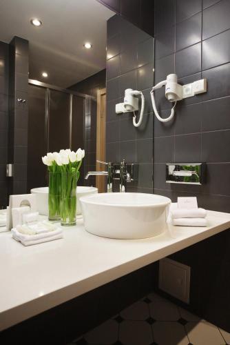 Ванная комната в Tulip Inn Rosa Khutor Hotel