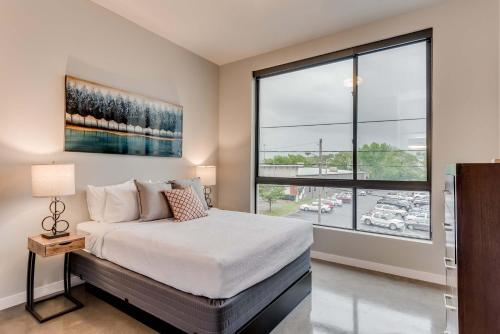 A bed or beds in a room at Stay Alfred at The James