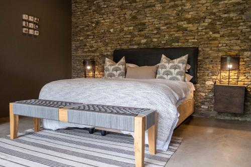 A bed or beds in a room at Tamboti River Lodge