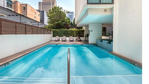 The swimming pool at or near Oaks Brisbane on Charlotte Suites