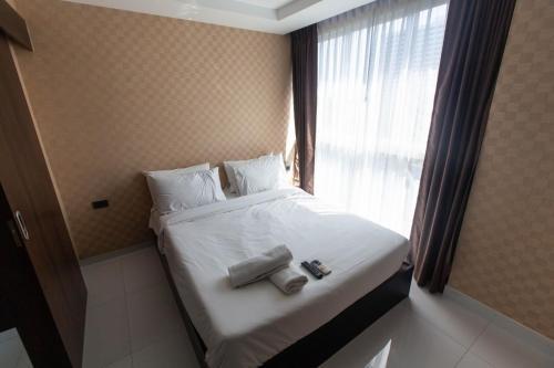 Кровать или кровати в номере Serenity Condo Wongamat by Patsamon