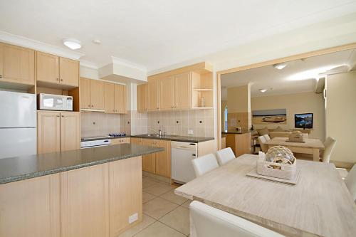 A kitchen or kitchenette at Hibiscus on the Beach