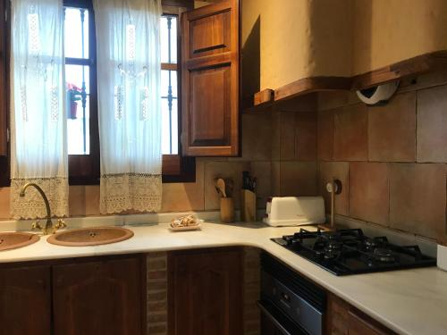 Una cocina o zona de cocina en Casa El Rincón