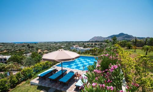A view of the pool at Kolymbia Village or nearby