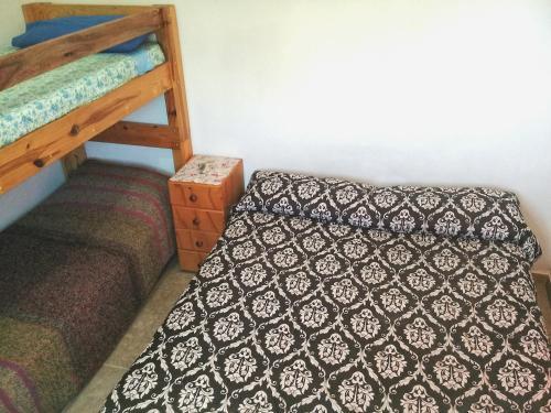 Una cama o camas cuchetas en una habitación  de DEPARTAMENTOS SOSA