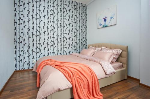 Кровать или кровати в номере Studiominsk Apartments