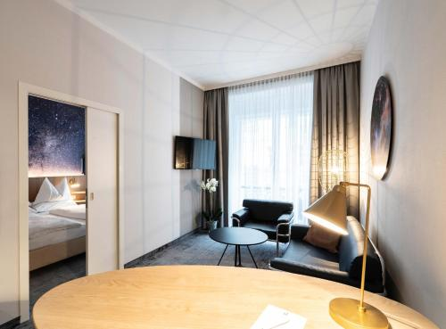 A television and/or entertainment center at Starlight Suiten Hotel Salzgries