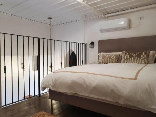 Cama ou camas em um quarto em Kubler's House