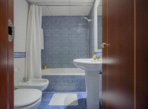 Ванная комната в Apartamentos Suites Oficentro