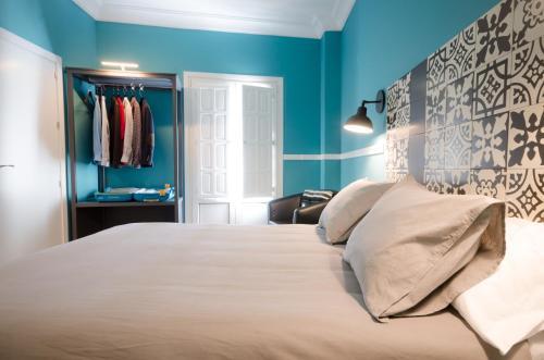 Cama o camas de una habitación en Apartamentos Suites Roma
