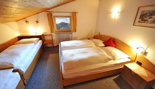 Łóżko lub łóżka w pokoju w obiekcie Residence Lastei