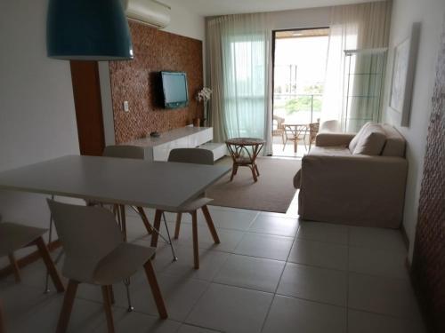 A seating area at Apartamento Barra de São Miguel