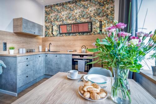 A kitchen or kitchenette at Best4Stay Apartment