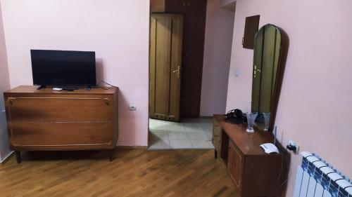 A television and/or entertainment center at Sara&Aram Apartments